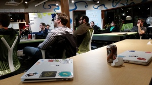 Attendees of the LeanDog meetup in the training room listen to the speaker of the night.