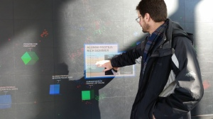 Passersby can touch any of the floating cubes to get course information, alumni profiles and other news.
