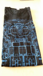 T-shirt featuring a blueprint design of everyone's favorite robotic lions that combine to form a giant sword-wielding robot. This medium-sized Voltron t-shirt can be yours!