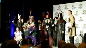 The judges on stage with their honorable mention costume contest participants