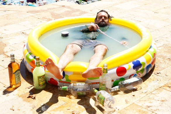 The Last Man on Earth, Phil Miller spends his days immersed in a margarita pool